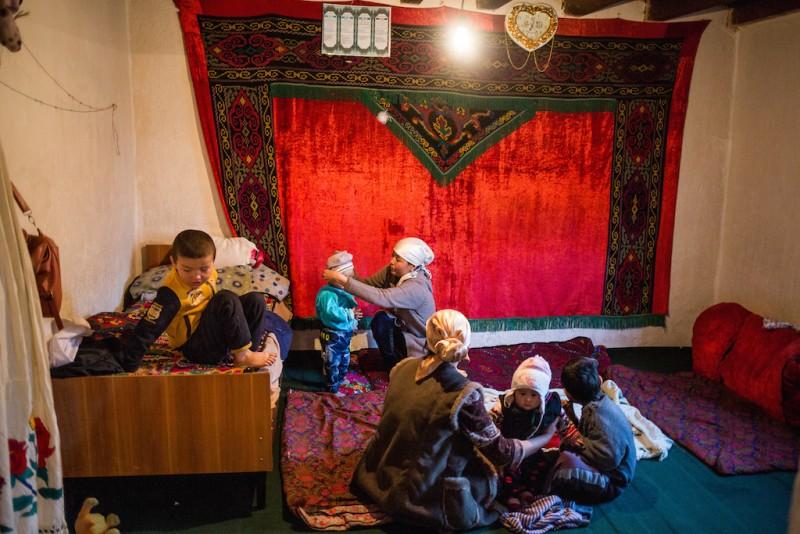 A family dinner of migrant workers. Djangijer village, Batken oblast.