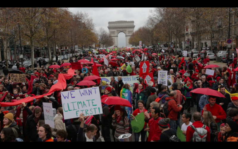 As world leaders in Paris were finalizing the text of the deal, thousands defied the ban on public protests implemented in France under the State of Emergency and gathered by the Arc de Triomphe on a climate demonstration. Photo: © Kristian Buus