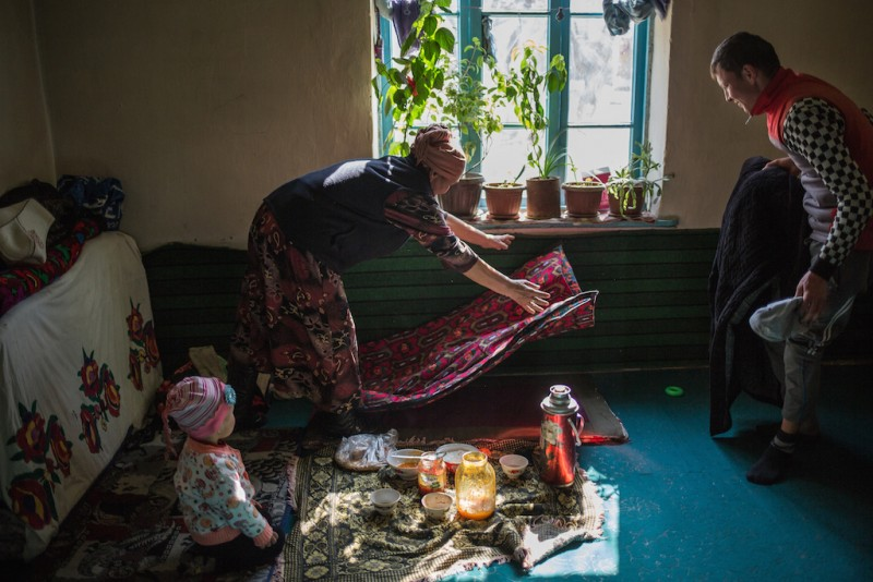 "Oyimnisa, 60 years old, raises her three grandchildren by herself. ""The younger granddaughter doesn't remember her mother as she was only eight months old when she left them and went to Russia. So, she does not ask me about her mother."" Djangijer village, Batken oblast."