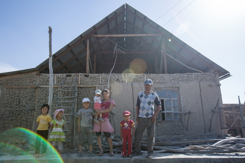 Akmal, 30 years old, constructs a new house while raising his four children, as well as two children from a neighbor. Normally, it is the women who are left behind, but Akmal's wife is the one who has trekked off to Russia. She works as a waitress in one of the countless cafés of Moscow. Batken city, Batken oblast.