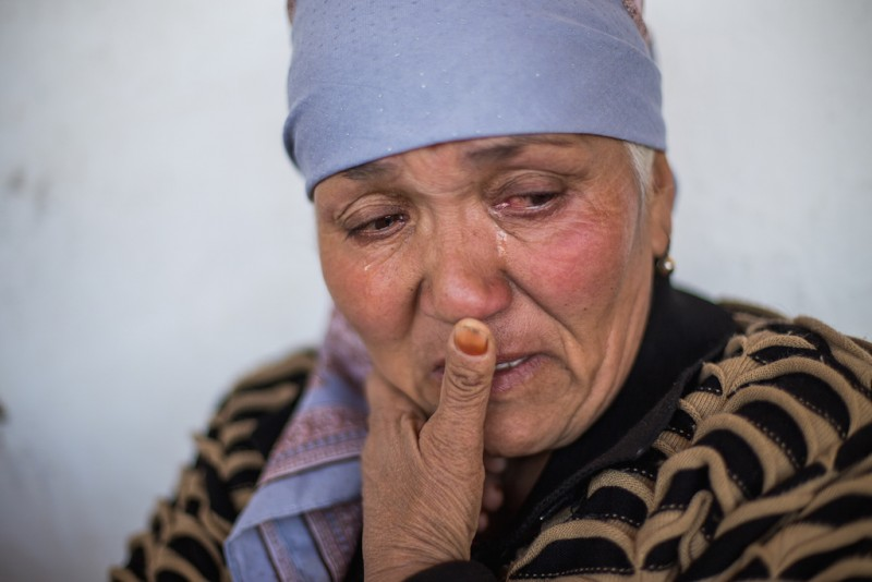 Anarbek's mother, 50 years old. The woman who facilitated the arrangement that initially brought Anarbek to Kazakhstan lived – and still lives – in Aravan. Throughout the nine years of his oddyssey, Anarbek's mother tried unsuccessfully to get answers from this women, who sometimes reacted violently. Aravan rayon, Osh oblast.