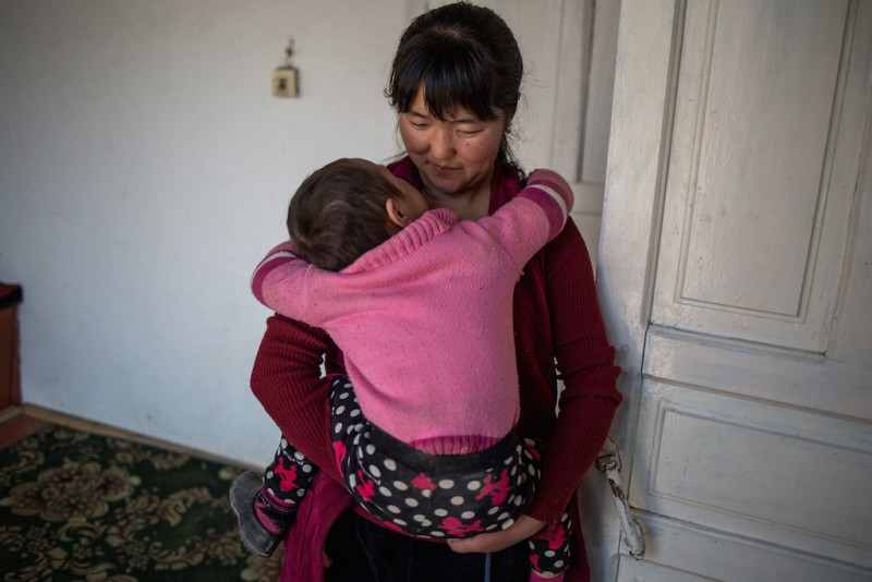 Begimay, 16 years old, takes care of her older sister's three children. Her older sister, brothers, and father all work in Russia. Djangijer village, Batken oblast.