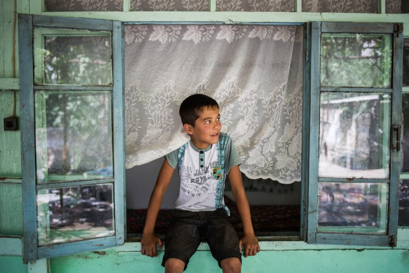 The children of a sanitation technician who lives in a small trailer somewhere in Moscow. His three children and wife wait in the family household for his return. Aravan rayon, Osh oblast.