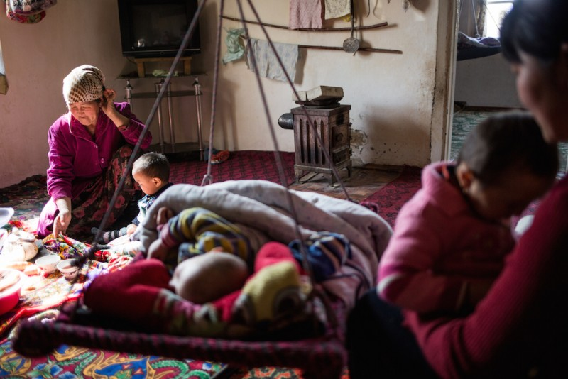 Begimay, 16 years old, and her mother Baysiya, 45 years old, take cares of the her older sister's three children. Her older sister, brothers, and father all work in Russia. Djangijer village, Batken oblast.