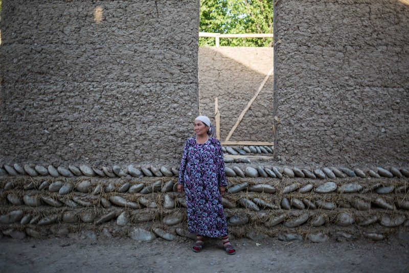 Aliya, 45 years old. Two of her sons and her husband work in Russia. She has been building their house using the money they have sent to her. Aliya has directly managed the construction process. Karabag village, Batken oblast.