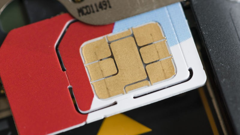 "Close up of a SIM-card being inserted into its socket inside a mobile phone. The SIM (""Subscriber Identity Module"") card holds security keys to identify and authenticate mobile telephony data. Image by Erik Tham. Copyright Demotix (21/2/2015)"