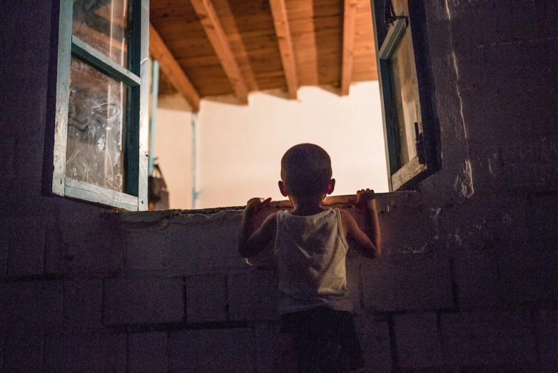 A boy addresses his mother. Chek village, Batken oblast.