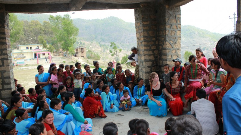 Nyaya Health: Mass Community Health Teaching - street theater on menstrual hygiene and the practice of Chhaupadi. Image from Flickr by Possible. CC By 2.0