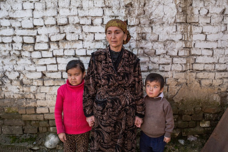 Mazur, 55 years old,  takes care of his five grandchildren. Their parents are constantly working in Russia. Osh city, Osh oblast.