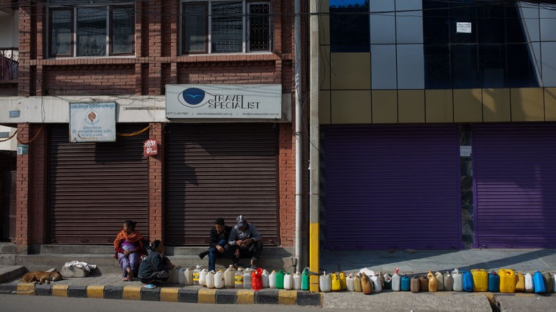 In BhatBatheni, Kathmandu, people queue for Kerasine. Two months after the gas, petrol and medicine shortages started people are still queuing for Kerasine and other fuels necessary for daily life in Kathmandu. Image by Samuel Duggan. Copyright Demotix (29/11/2015)
