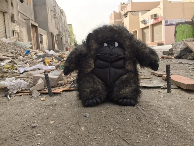 A giant Godzilla-like ape appears to guard a makeshift barricade put up by protesters in Bahrain today. Barricades made out of debris, construction material, plants and rubbish are erected by protesters on roads leading to protest spots to stall the riot police from attacking the protesters in full force. Source: Unknown