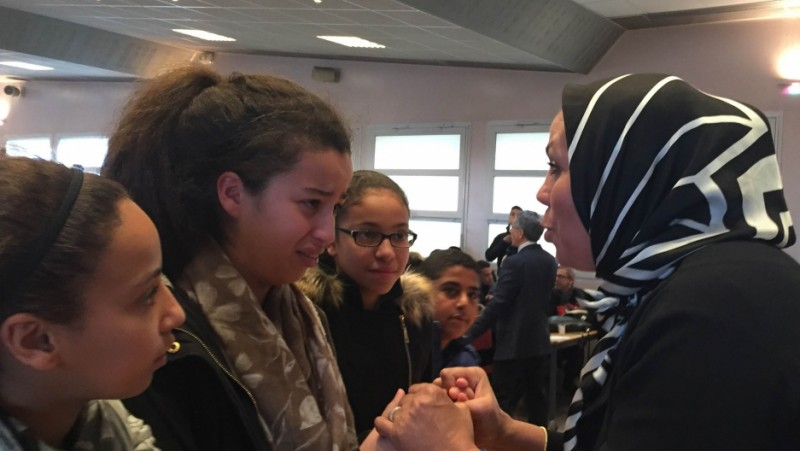 Latifa bin Ziaten (r) speaks with students about her son, Imad, who was murdered by Islamic extremist Mohamed Merah. At the end of her talk, students hug her. One girl says Latifah reminds her of her own mother. Credit: Marine Olivesi. Used with PRI's permission.