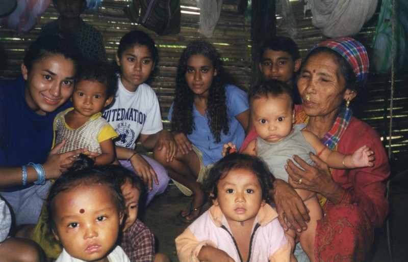 Luna Acharya Mulder, center, with family members in Nepal. Credit: Courtesy of Luna Acharya Mulder. Used with PRI's permission.