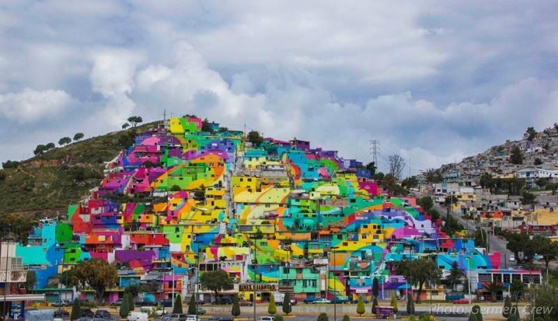 """Las Palmitas und das """"Makro-Wandgemälde"""" in seiner Endfassung. Foto mit freundlicher Genehmigung von der Gemeinschaftsseite der Germen Crew auf Facebook."""