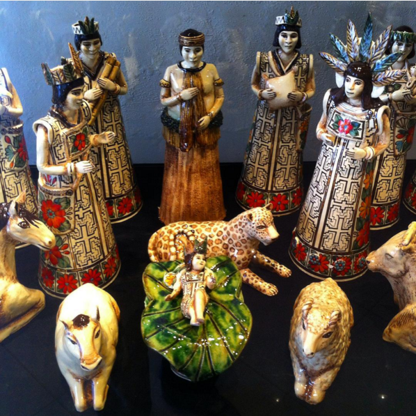 This is part of the XI national contest of nativity scenes. Crafted  with Shipibos,  Peruvian amazon jungle people. The textile of the cushma (tunic) depicted is typical but stylized. Among the usual nativity animals there is a jaguar.