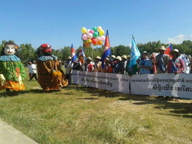 About 700 people in Kampong Chhnang carry puppets to represent rights, freedom and good luck for all marchers. Photo and caption from Licadho, a human rights group.