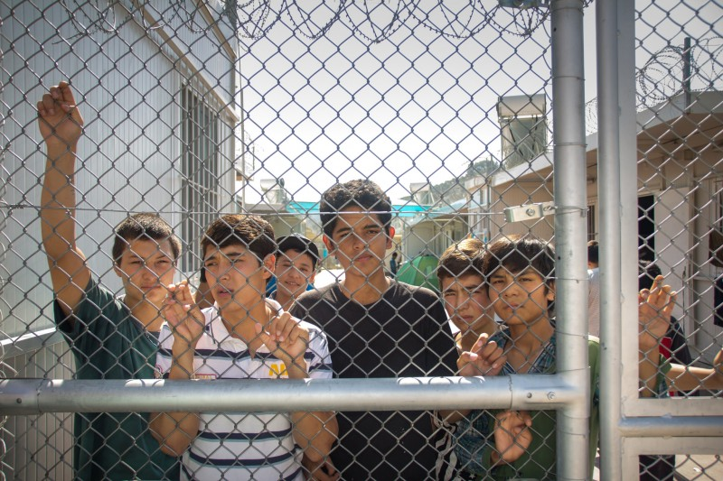 Greece: Lesbos, 2015. The migrants at Moria Identification Centre, who come from Afghanistan, Pakistan, Eritrea and many other  countries, are detained by the police. Photo by International Federation of Red Cross and Red Crescent Societies, used under a CC BY-NC-ND 2.0 license.