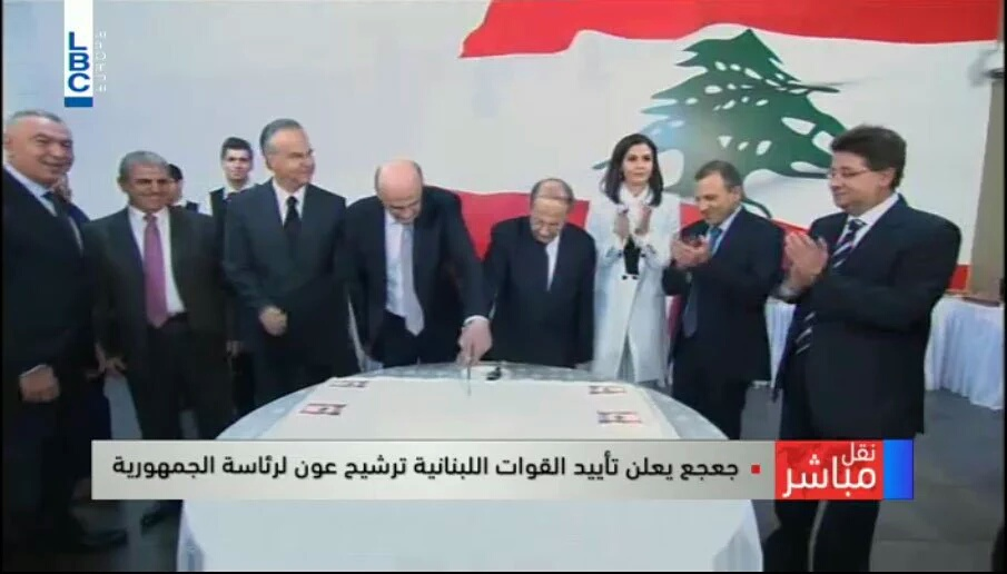 Samir Geagea (left) and Michel Aoun (right) cutting a cake to celebrate the former's endorsement of the latter (screenshot of television appearance on LBC Lebanon)