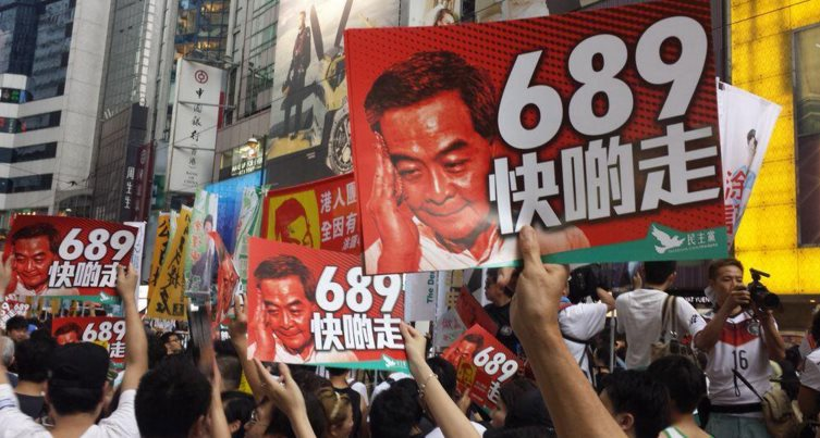 The protest sign says: 689 steps down ASAP. Photo: HKFP.