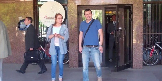 Editor in Chief of Fokus magazine Jadranka Kostova and journalist Vlado Apostolov coming out from Court hearing in May 2013. Video screen-grab from a1on.mk