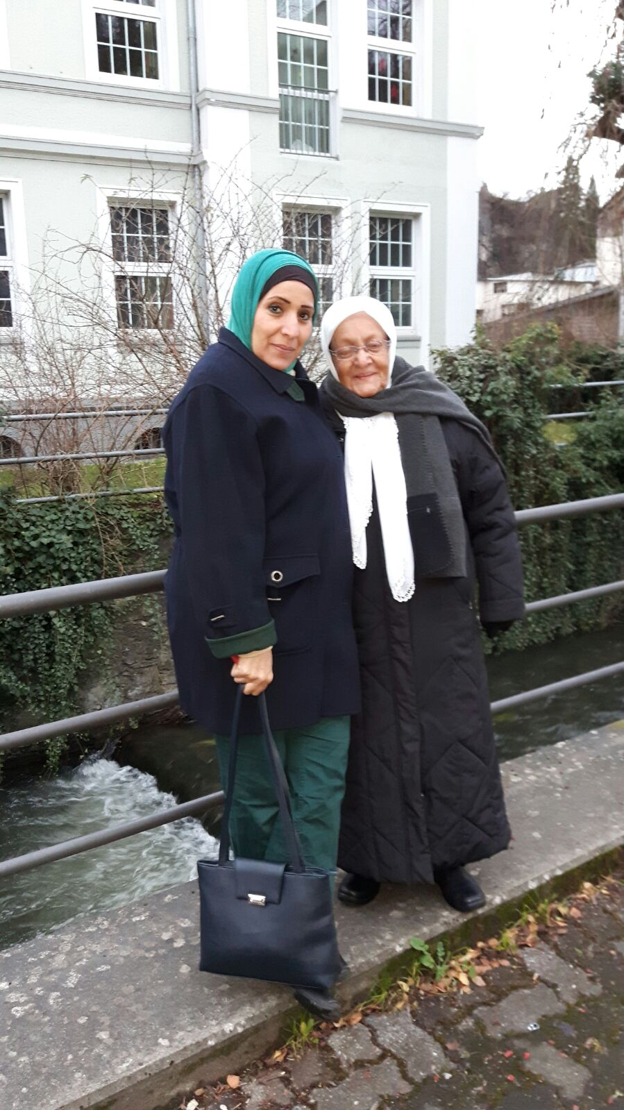 Nadera Aboud, with her daughter Mona (l). Credit: Rebecca Collard. Used with PRI's permission