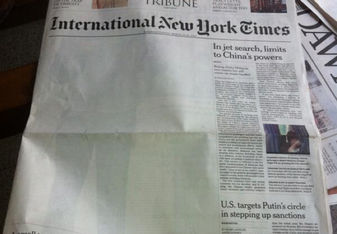 Front page of International New York Times, with story on Bin Laden omitted. Photo by Aysha Raja, shared on Twitter.
