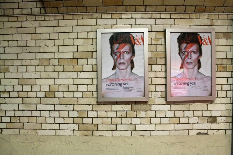 'Bowie is watching you' -- Posters for the David Bowie exhibit at the V&A; photo by Sarah Stierch, used under a CC BY 2.0 license.
