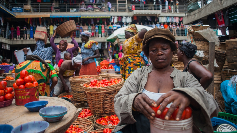 Matilda Moses sells tomatoes in Tudu Market, part of a sprawling district of open-air and covered markets in central Accra. She can make the equivalent of 300 dollars in sales in a good week. Credit: Yepoka Yeebo. Used with PRI's permission