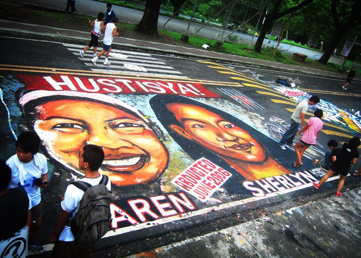 A street inside a university was painted with the faces of two student leaders abducted in 2006 by suspected military agents. The students were campaigning for land reform during that time. An army officer is currently facing trial in connection to the case. The two students are still missing. Image from the Facebook page of Ang Gerilya