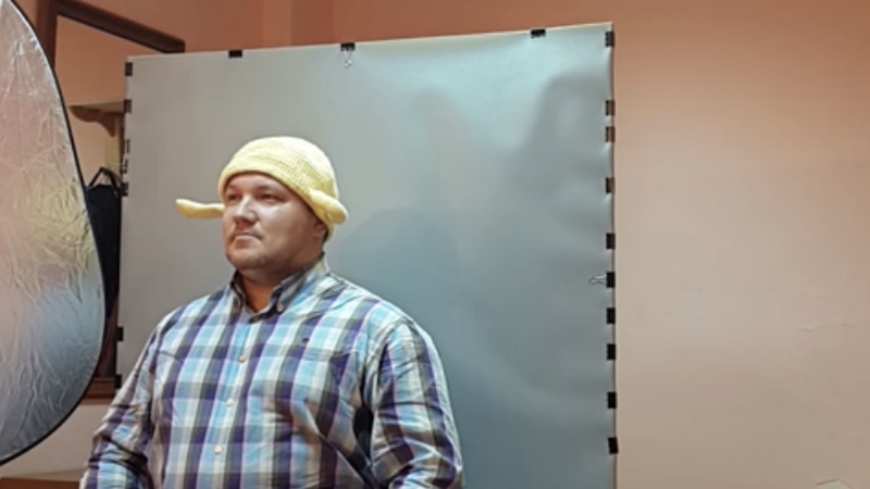 Pastafarian Andrei Filin got his wish: here he is getting his driver's license photo taken wearing a colander. Screencap from YouTube.