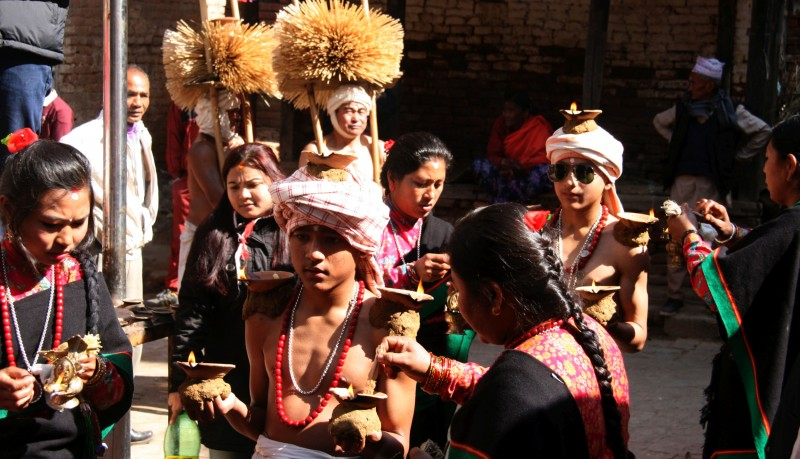Nepalese Hindu devotees carry oil lamps on their body parts during the Madhav Narayan festival celebrations in Thecho, Lalitpur, Nepal. Image by Archana Shrestha. Used with permission.