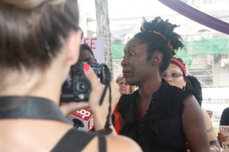 Activist Attillah Springer, one of the organisers of last Friday's protest, talks to the media. Photo courtesy Janine Mendes-Franco.