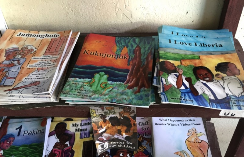 Some of the titles in One Moore Book's series for Liberian children. Credit: Prue Clarke. Used with PRI's permission