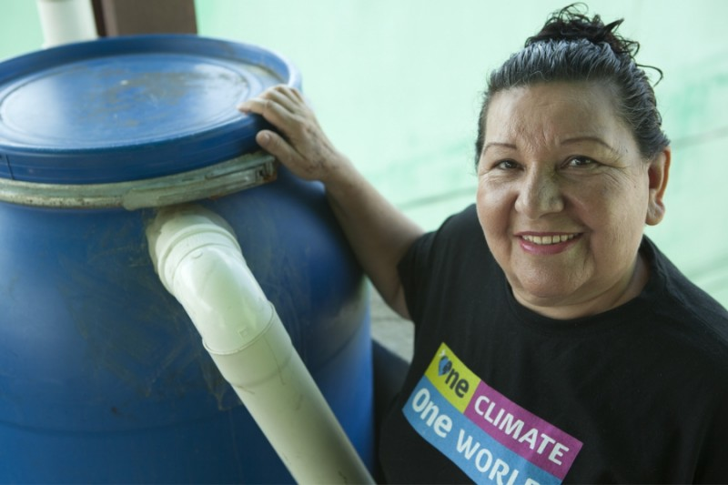Terezinha da Silva with one of the her signature rain barrels. Credit: Anne Bailey. Used with PRI's permission