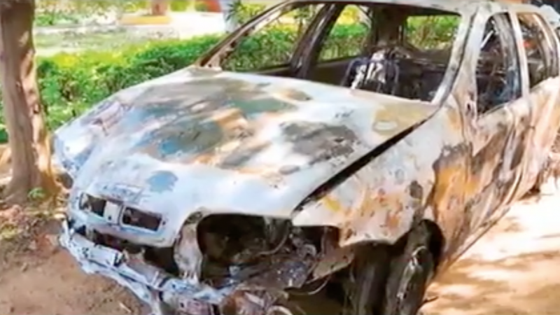 Screenshot of the torched car from which Tanzanian students were dragged out and beaten.