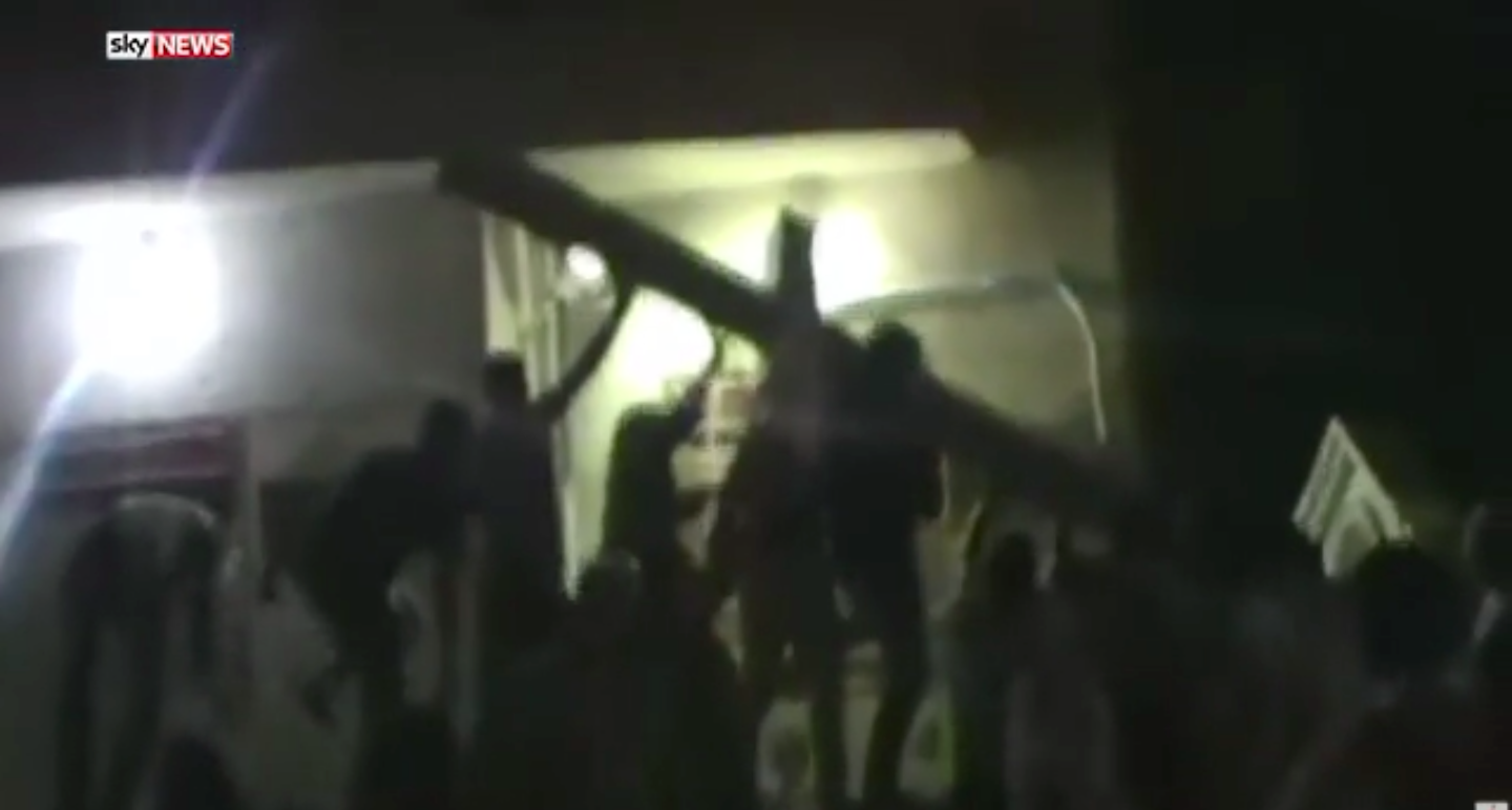 Anti-ISIS activists in Raqqa raising a cross after the terror group took it down. Footage