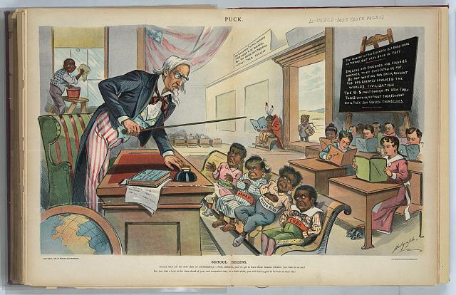 "Print shows Uncle Sam as a teacher, standing behind a desk in front of his new students who are labeled ""Cuba, Porto Rico, Hawaii, [and] Philippines""; they do not look happy to be there. At the rear of the classroom are students holding books labeled ""California, Texas, New Mexico, Arizona, [and] Alaska"". At the far left, an African American boy cleans the windows, and in the background, a Native boy sits by himself, reading an upside-down book labeled ""ABC"", an a Chinese boy stands just outside the door. A book on Uncle Sam's desk is titled ""U.S. First Lessons in Self-Government"". 1899. Dalrymple, Louis. Image and caption from the United States Library of Congress"
