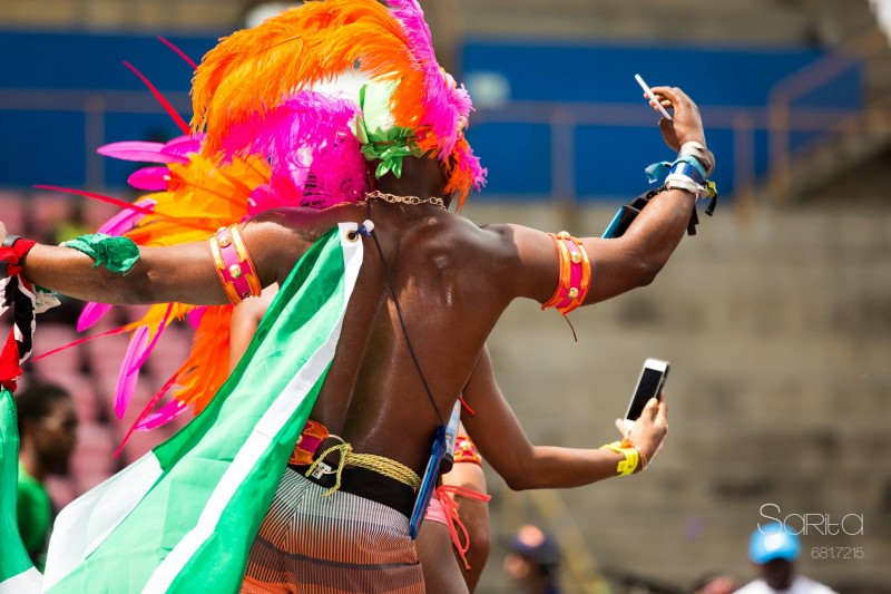 Masqueraders on stage -- with their phones -- during Trinidad and Tobago Carnival 2016. Image by Sarita Rampersad, used with permission.