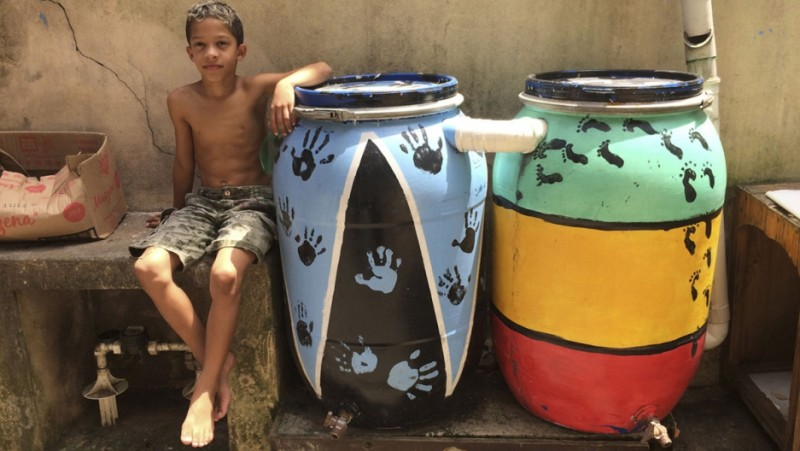 Two of about 50 rain barrels in the Vergueirinho favela in São Paolo, Brazil. Terezinha da Silva taught residents how to build the barrels to conserve water. Credit: Anne Bailey. Used with PRI's permission