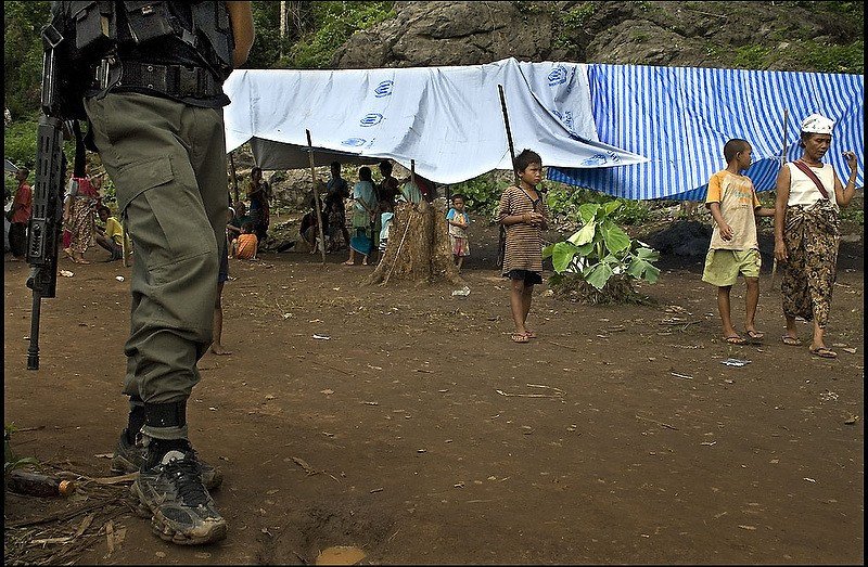 A Thai soldier stands guard at a camp for Karen refugees on the Thai/Myanmar border. Image and caption from the Flickr page of Rusty Stewart (CC License)