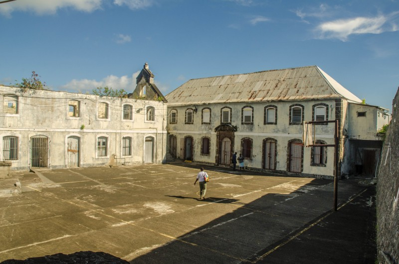The courtyard at Fort George, Grenada, where Maurice Bishop, leader of the People's Revolutionary Government, along with seven other Cabinet members, were executed by firing squad on October 19, 1983, after a coup led by factions within the party. Photo by Wayne Hsieh, used under a CC BY-NC 2.0 license.