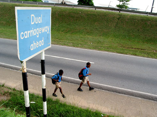 Two students on their way home from school in Trinidad and Tobago. Photo by Georgia Popplewell, used under a CC BY-NC-ND 2.0 license.