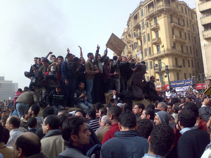 Demonstrators atop an army truck in Tahrir Square in Cairo, January 2011. Photo by Ramy Raoof via Wikimedia (CC BY 2.0)