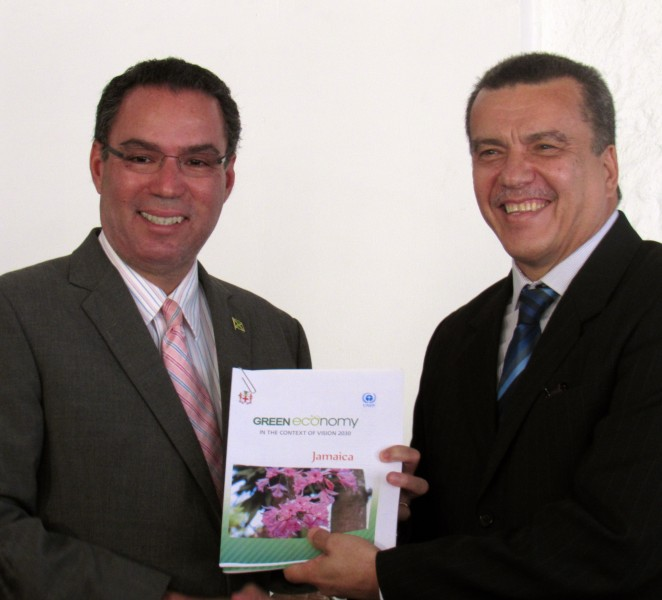Daryl Vaz , Jamaica's Minister Without Portfolio in the Ministry of Economic Growth and Job Creation (responsible for environment and climate change; left) and Leo Heileman of UNEP's Regional Office for Latin America and the Caribbean (right), receiving a report on Jamaica and the Green Economy. Photo courtesy Jovan Evans, used with permission.