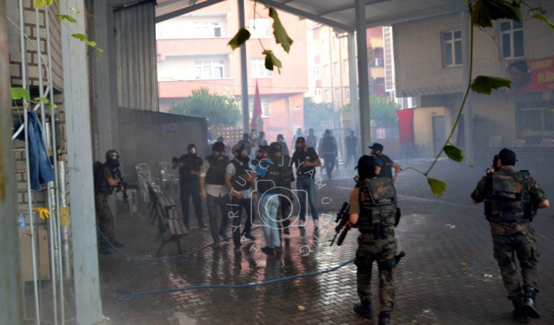 On 26 July 2015, Turkish police special forces stormed Gazi Cemevi, a place of worship for Alawites, with tear gas and rifles at Istanbul's Gazi neighbourhood. The operation aimed at confiscating the body of Günay Özarslan, who was killed in a police raid two days before --public funerals is a form of protest for the minorities in Turkey. Photo by Hayri Tunç.