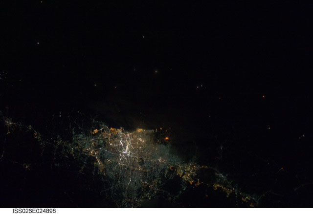 Jakarta at night. Indonesia. Image courtesy of the Earth Science and Remote Sensing Unit, NASA Johnson Space Center