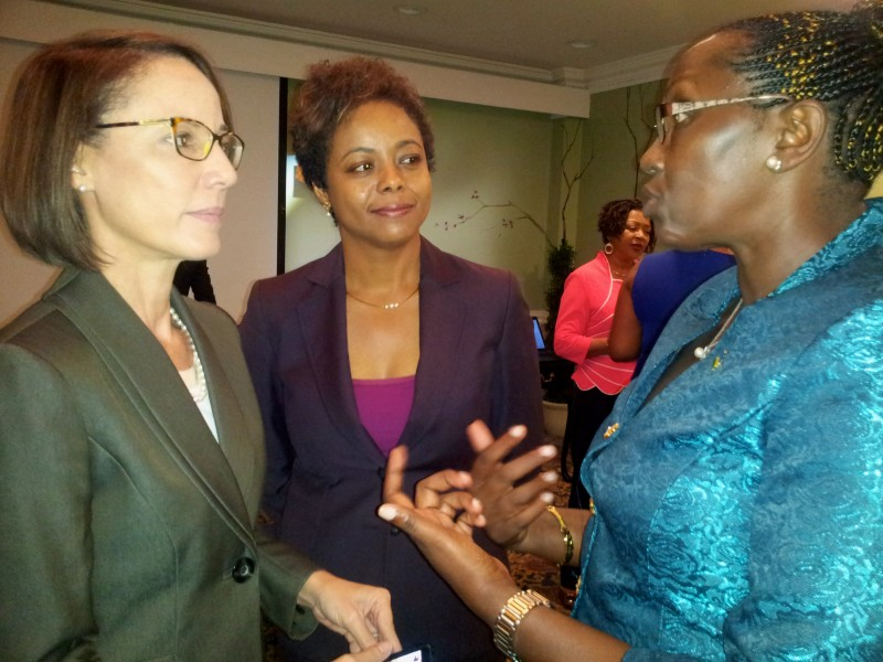 Jamaica's new Minister of Foreign Affairs and Foreign Trade, Kamina Johnson Smith (left); and Attorney General Marlene Malahoo Forte (centre) speaking with Rwandan Member of Parliament Juliana Kantengwa during the Jamaica-Rwanda Exchange at the University of the West Indies Mona campus in November, 2015. Photo by Emma Lewis, used with permission.