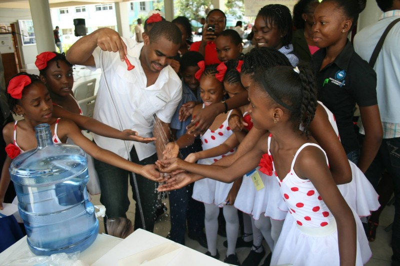 Jamaican 'green' entrepreneur Jovan Evans, demonstrating his invention on World Water Day. Photo courtesy Mr. Evans, used with permission.