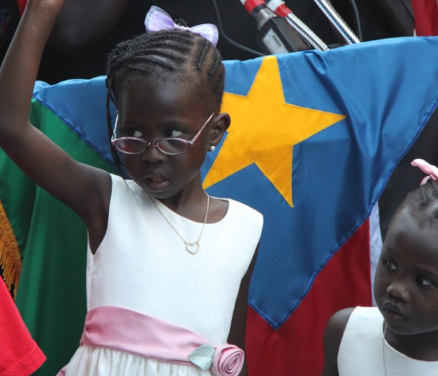 A South Sudanese girl at independence festivities: Is there a bright future for this Sudanese girl who celebrated independence in 2011? Public domain image -- original by Jonathan Morgenstein/USAID on Flickr.