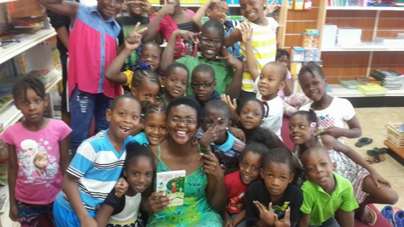 Publisher Tanya Batson-Savage visits the Trench Town Reading Centre in Jamaica. Photo by the author, used with permission.